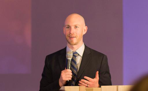 Photo of Walt Quick preaching at Highrock Cambridge